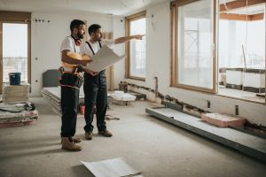 two general contractors reviewing plans during remodel